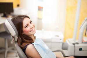young adult girl in dental chair